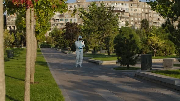 Thumbnail for Virologist in Protective Equipment Disinfects Surfaces in a Quarantined Park Against the Covid-19