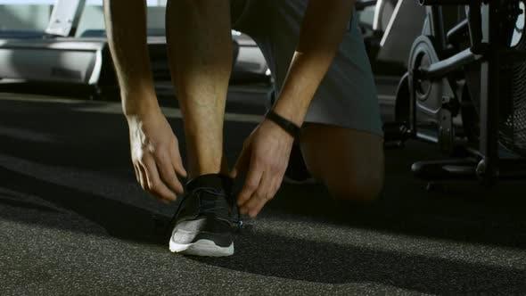 Thumbnail for Man Tying Shoelaces