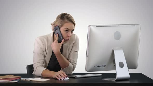Thumbnail for Attractive Young Woman Talking on the Mobile Phone and Smiling While Sitting at Her Working Place in