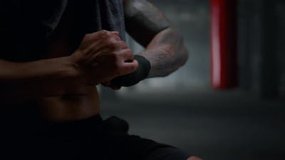 Kickboxer Using Boxing Tapes for Training