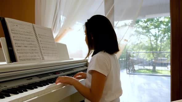 Cover Image for Child Girl Playing the Piano