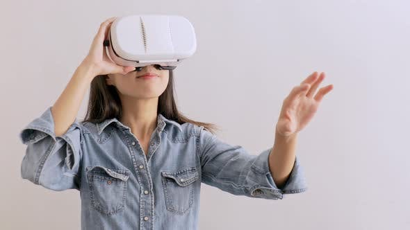 Thumbnail for Woman looking though virtual reality device