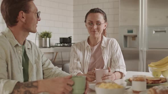 Spouses Talking over Breakfast