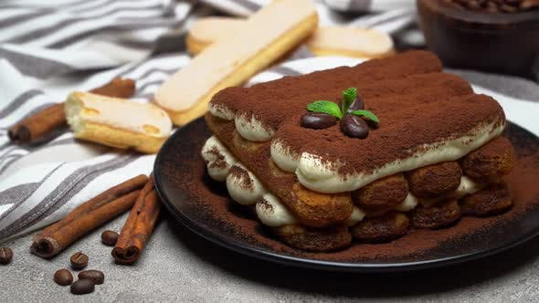 Thumbnail for Classic Tiramisu Dessert and Savoiardi Cookies on Ceramic Plate on Concrete Background