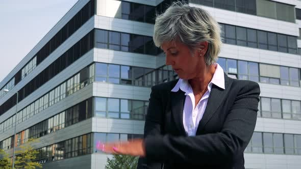 Thumbnail for Business Middle Age Woman Adjusts Clothes and Then She Smiles To Camera - Company Building