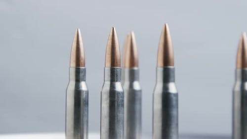 Cinematic rotating shot of bullets on a metallic surface - BULLETS 024