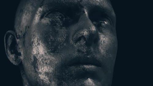 Metallic Grungy Sculpted Man Face In Dark Background