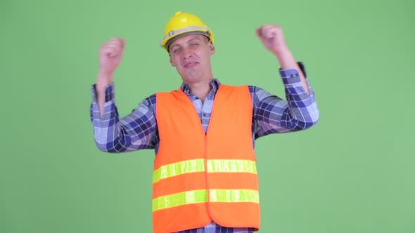 Thumbnail for Happy Young Man Construction Worker Getting Good News