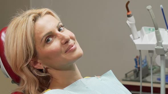 Thumbnail for Beautiful Mature Woman Smiling Joyfully Sitting in Dental Chair