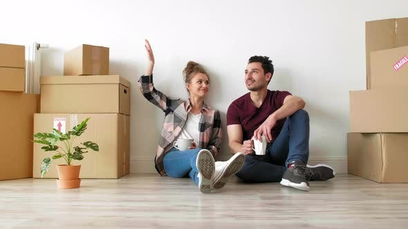 Thumbnail for Young couple catching a break while moving house