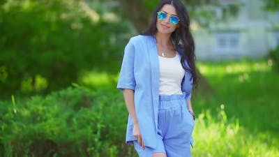 Woman in Blue Costumes and Sunglasses