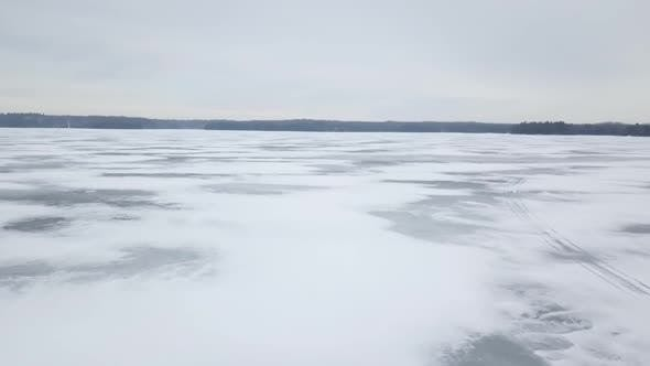 Thumbnail for Aerial Drone View Flying Above Frozen Ice Lake In Winter