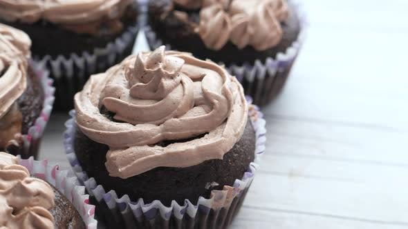 Top View of Chocolate Cup Cake on Wooden Table.