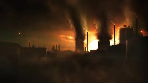 Dystopic Sci-Fi Concept Shot of Heavy Industry Causing Climate Change and Air Pollution