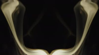 Incense smoke swirling on black background