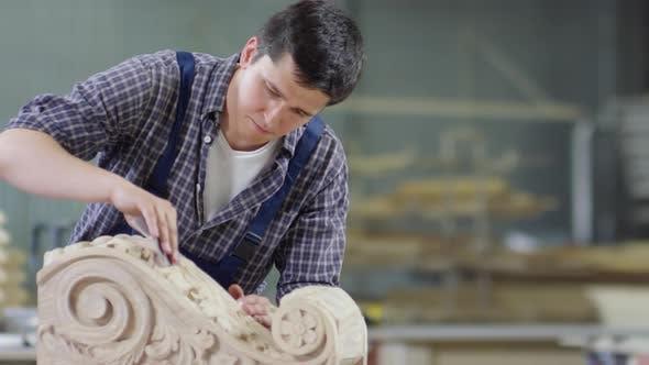 Thumbnail for Carpenter Sanding Wood in Joinery