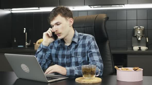 Thumbnail for Businessman talking to business contact or friend at home workplace. Working from home