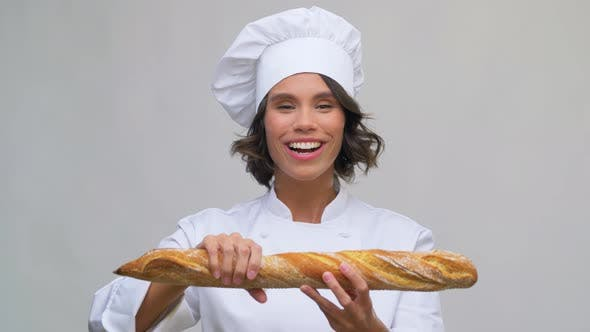 Happy Female Chef with French Bread or Baguette