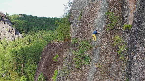 Free Solo Climbing on a Rock Wall in the Siberian Nature Reserve Stolby
