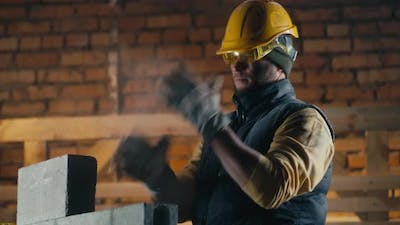 Male Builder Coughing During Work