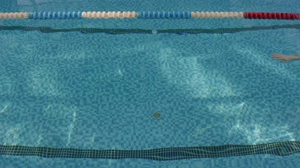 Male Swimmer Practicing in Pool