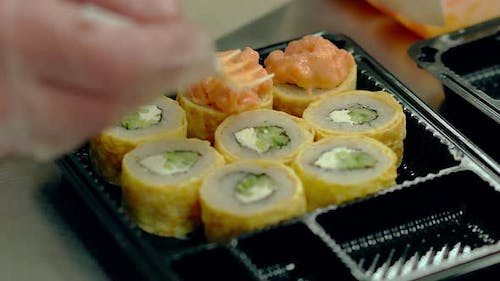 Chef Decorates Creamy Fried Japanese Rolls with an Omelette