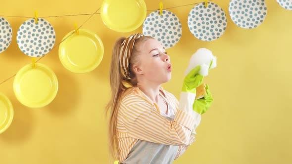 Pleasant Cute Woman in Gray Apron Having Fun with Foam