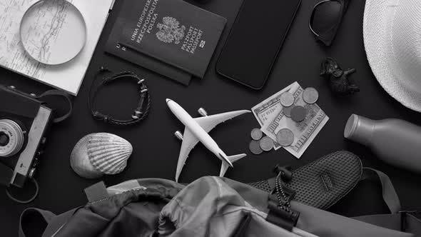 Thumbnail for Travel and Tourist Concept. Vacation and Travel Accessories Placed on Black Background.