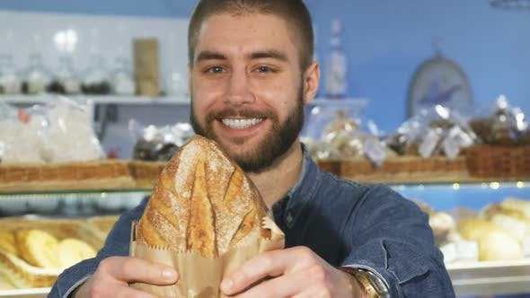 Thumbnail for Happy Handsome Bearded Man Posing with Freshly Baked Bread
