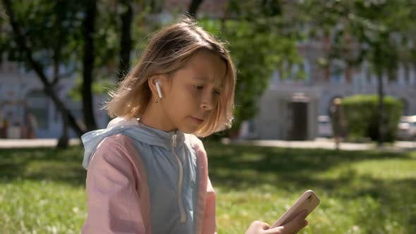 Thumbnail for People, Children and Technology Concept - Girl with Laptop Computer and Smartphone Taking Selfie