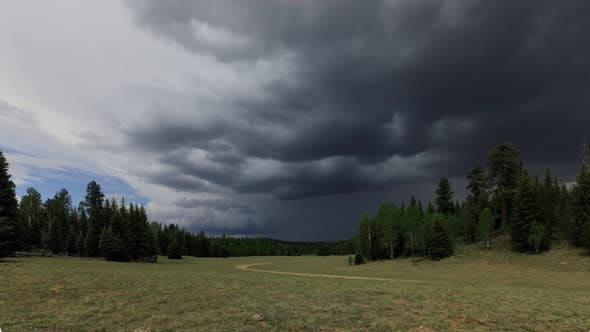 Thumbnail for Time Lapse of dark and ominous storm clouds forming over a meadow.