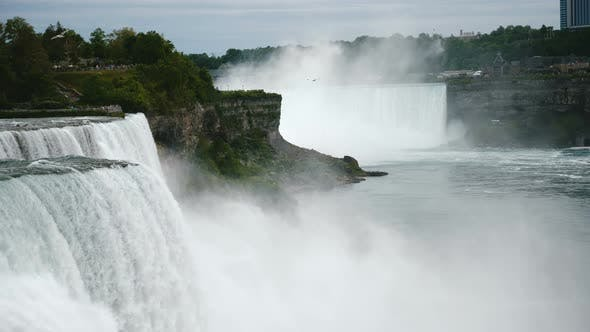 Thumbnail for Scenic Wide Shot of Birds Flying Above Rushing Water and Spray at Beautiful Niagara Falls