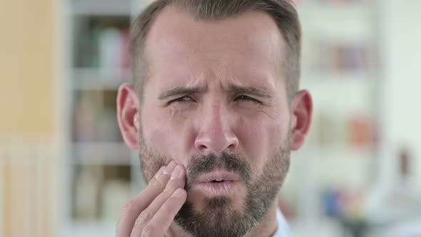 Close Up of Young Man with Infectious Toothache