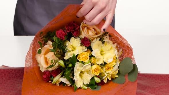 Thumbnail for Florist Does a Wrap for Bouquet Flowers