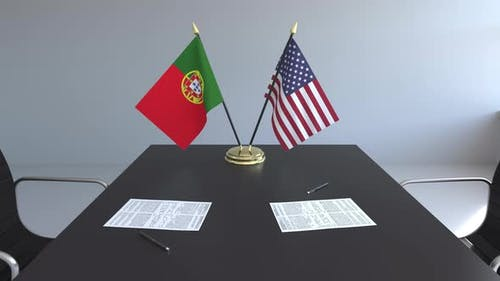 Flags of Portugal and the United States of America on the Table
