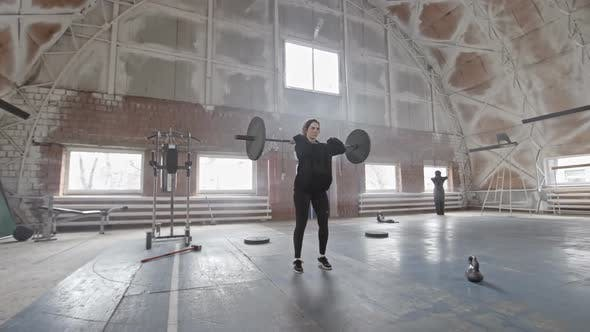 Thumbnail for Female Athlete Doing Barbell Lunge