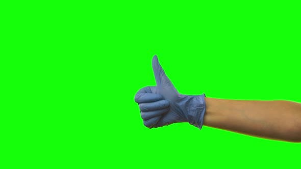 Thumbnail for Doctors Female Hand in Blue Glove Is Holding Thumb Up Making Gestures Like. Green Screen. Close Up