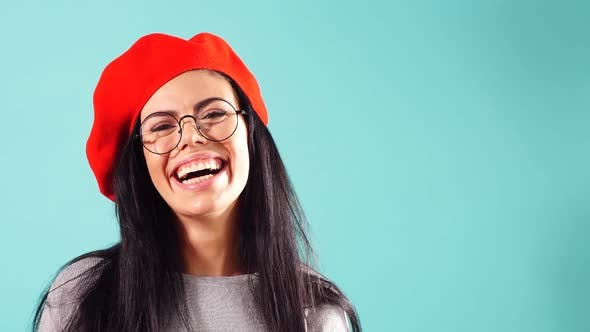 Thumbnail for Glamorous Portrait of a Smiling Beautiful Woman in a Red Beret