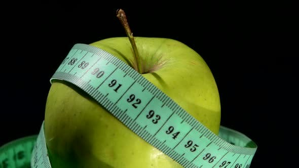 Thumbnail for Green, Fresh Apple with Measuring Tape on White, Rotation, Reflection