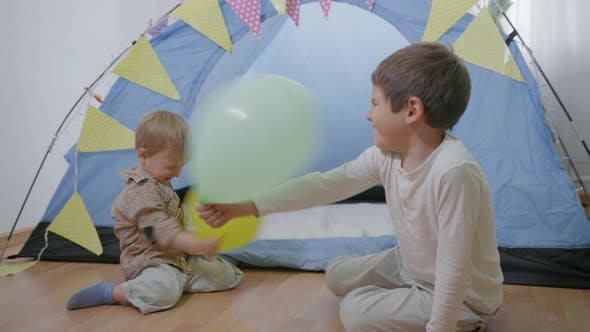 Fun Games, Cheerful Friendly Brothers Enjoy Spending Time Together Playing Balloons