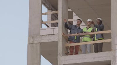 Colleagues in Multistory Building Under Construction