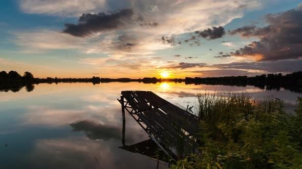 Thumbnail for Timelapse of Old Fishing Bridge on the Lake at Sunset. Fishing on the Lake.