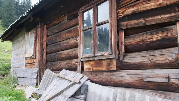 Tradition Old Wooden House on Hill in the Carpathian Mountains Near Green Valley