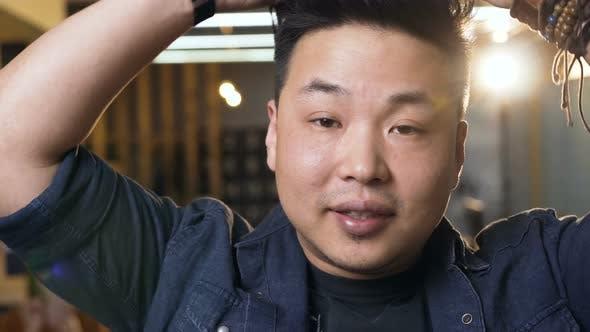 Thumbnail for Young Korean Man Removing Virtual Reality VR Glasses