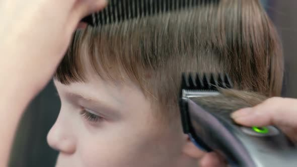 Thumbnail for Barber Cutting Boy's Hair with Clipper