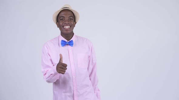 Thumbnail for Young Happy African Tourist Man Giving Thumbs Up