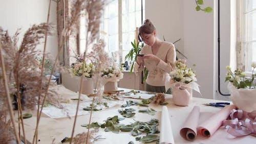Female Florist Making Photos in Floristic Studio