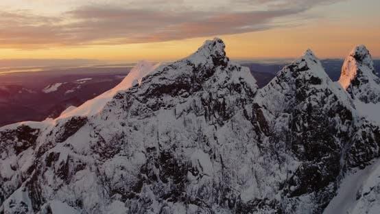 Thumbnail for Amazing Nature Brilliant Luminous Orange Light Three Fingers Mountain Peak With Snow Seascape