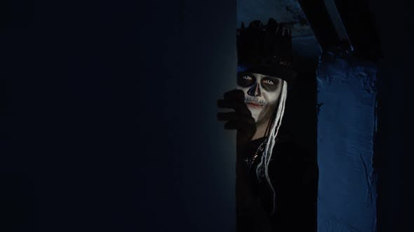 Thumbnail for Creepy Man with Halloween Skeleton Makeup Slowly Appears From Dark Corner with Frightening Smile