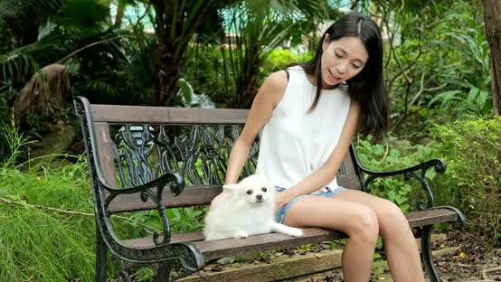 Thumbnail for Woman enjoy time with her dog at park